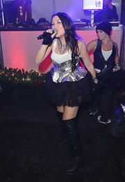 Manika showed her rocker girl style at Paris Hilton's Christmas party in a frothy metallic number.