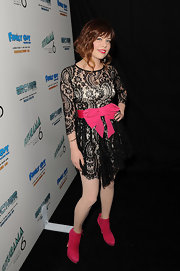 Kady Z wore a black lace cocktail dress with a hot pink bow and matching booties for Paris Hilton's Christmas party.