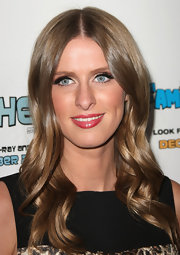 Nicky Hilton wore her golden locks in long curls at Paris Hilton's Electric Christmas Holiday Party