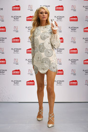 Paris Hilton matched her dress with a pair of strappy silver pumps by Jimmy Choo.