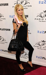 Paris paired her patent leather tote bag with an all black look and leopard print heels.
