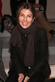 Nina Garcia cozied up with a brown wool coat white watching the Paris68 Fall 2010 fashion show.