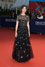 Astrid Berges Frisbey looked downright adorable in a star-embellished black tulle gown by Chanel at the Deauville American Film Fest premiere of 'Pasolini.'