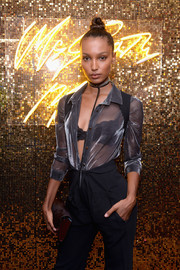 Jasmine Tookes turned heads in a sheer gray top and a lacy black bra at the Pat McGrath Unlimited Collection launch.