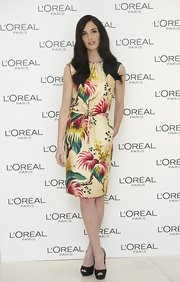 Paz Vega teamed her tropical print dress with classic black platform peep-toes.