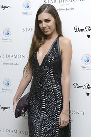 Amber Le Bon carried her party necessities in a quilted purse at the PeaceEarth Foundation fundraising gala.