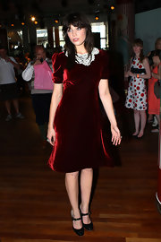 Daisy Lowe looked school girl chic in a red velvet dress with a crocheted collar at the launch of her vintage inspired fashion collection in London.