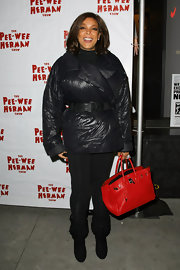 Wendy Williams paired her winter ensemble with a red leather Birkin bag.