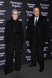 Meryl Streep finished off her all-black look with a wool coat.