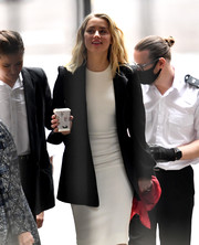 Amber Heard layered a black Bella Freud blazer over a fitted LWD for the penultimate day of Johnny Depp's libel trial.