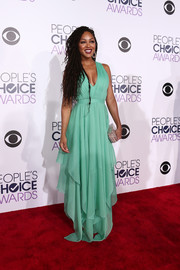 Meagan Good was all about boho glamour at the People's Choice Awards in a seafoam-green gown with a plunging neckline and a handkerchief hem.