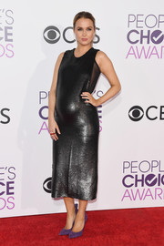 Camilla Luddington wore a pair of purple pumps for a splash of color to her look.