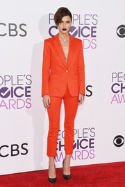 Ruby Rose opted for a Veronica Beard pantsuit in a dazzling red-orange hue when she attended the 2017 People's Choice Awards.