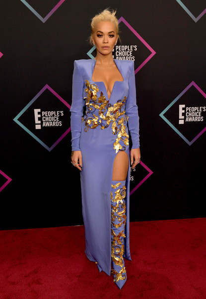 Rita Ora cut a strong silhouette in a periwinkle Atelier Versace column dress with bold shoulders and gold embellishments at the 2018 People's Choice Awards.