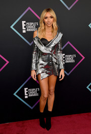Giuliana Rancic completed her edgy look with black ankle boots.