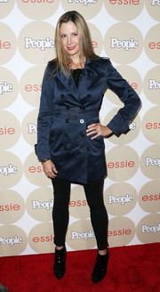 Mira Sorvino went to the Ones to Watch party looking classic in a blue trenchcoat.