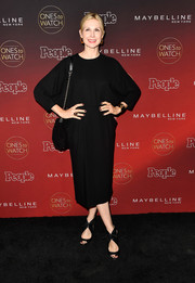 Kelly Rutherford attended People's Ones to Watch event wearing black lace-up peep-toes and a loose midi dress.
