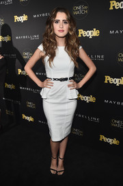 Laura Marano styled her dress with classic black ankle-strap heels.