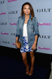 Jeannie Mai used a washed-out jean button-down as a chic cover-up when she attended the People StyleWatch Denim Awards.