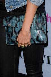 Nikki Reed carried a super-chic printed snakeskin clutch when she attended the People StyleWatch Denim Awards.