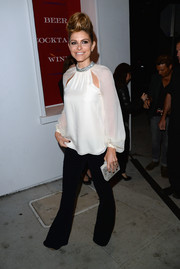 Maria Menounos was 1970s-glam in flared black pants and a loose white blouse at the People StyleWatch Denim Awards.