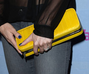 Astrid McGuire added some brightness to her ensemble with this yellow box clutch when she attended the People StyleWatch Denim Awards.