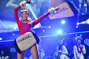 Miley Cyrus hit the stage at the Jingle Ball in Tampa carrying an oversized fur bag by Chanel.