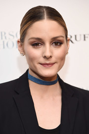 Olivia Palermo attended the New York premiere of 'Personal Shopper' wearing her hair in a center-parted chignon.