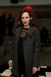 Charlotte kept warm in a wool trench coat while attending the Peter Som fashion show.