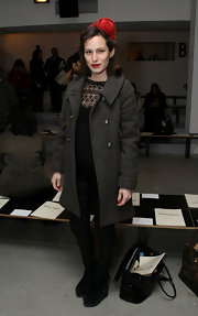 Charlotte paired her wool coat with a cool pair of wedge boots.