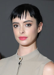 Krysten Ritter opted for a bright coral-pink lipstick at the Peter Som fall 2012 fashion show.