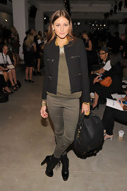 Olivia paired her tweed blazer and olive green leggings with cool lace up ankle boots.