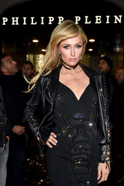 Paris Hilton toughened up a beaded LBD with a lace-up leather jacket, both by Philipp Plein, for the brand's boutique opening in Milan.