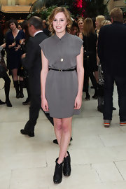 Laura Carmichael finished her look by wearing a pair of ankle boots with gold metal studs on platform heels.