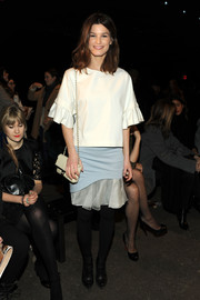 Hanneli Mustaparta contrasted her feminine outfit with edgy black ankle boots.