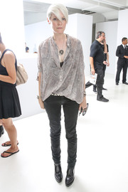 Kate Lanphear attended the Philosophy by Natalie Ratabesi fashion show wearing a slouchy snakeskin-print blouse.