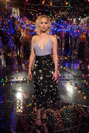 Jennifer Lawrence nailed mismatched chic with this Altuzarra floral skirt and cherry-print top combo.