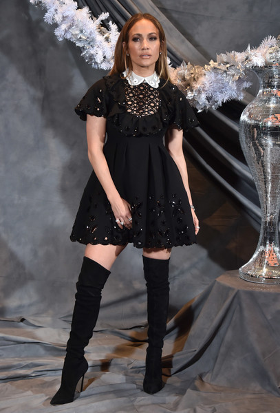 Jennifer Lopez channeled her inner little girl in a black baby doll dress by Valentino for the photocall of 'Second Act.'
