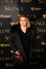 Catherine Deneuve struck a pose during the 'Silence' photocall wearing an oversized fur-collar jacket.