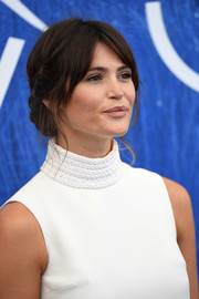 Gemma Arterton looked charming with her braided chignon at the Venice Film Festival photocall.