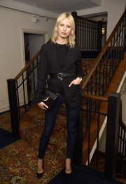A black leather clutch with gold buckle detail finished off Karolina Kurkova's ensemble.