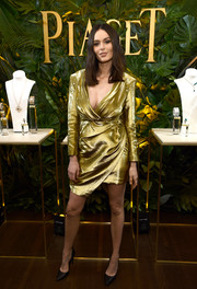 Nicole Trunfio shimmered in a chic gold wrap dress at the Piaget Independent Film celebration.