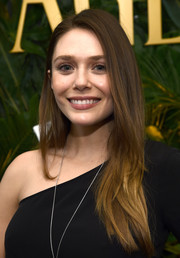Elizabeth Olsen wore her hair loose in a side-parted layered style at the Piaget Independent Film celebration.