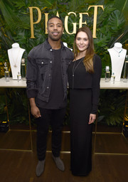Elizabeth Olsen paired a long black skirt with a matching one-sleeve top for the Piaget Independent Film celebration.