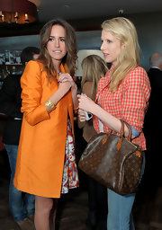 Lucy Punch attended the Piaget Hollywood Lunch carrying a stylish Louis Vuitton tote.