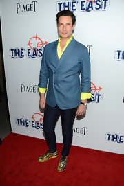 Cameron balanced out his bright top and blazer with a pair of dark-wash skinny jeans.