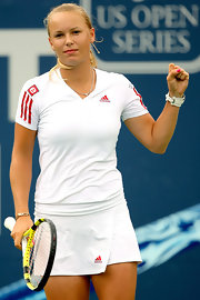 Caroline Wozniacki wore a white Adidas top with red accents.