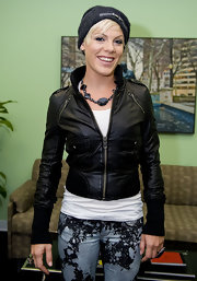 Pink rocked bleached-out jeans with a leather, zip-up jacket.