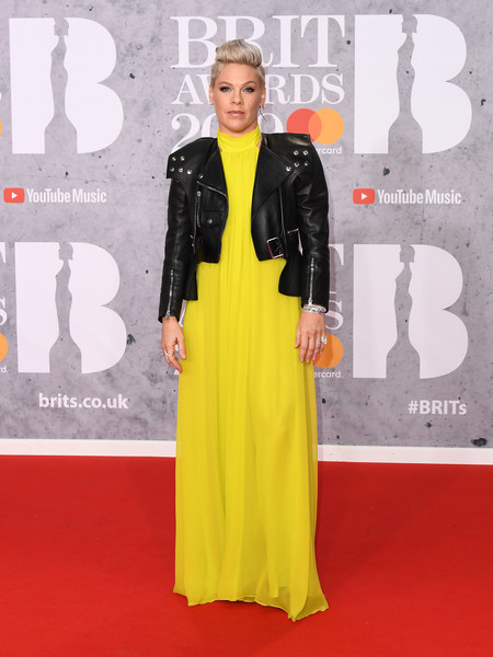 Pink Jumpsuit [outstanding contribution to music award,red carpet,carpet,clothing,yellow,fashion,dress,premiere,flooring,formal wear,a-line,red carpet arrivals,winner,brit awards,pink,england,london,the o2 arena]