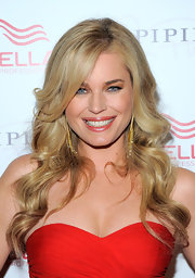 Rebecca Romijn opted for long lustrous curls at the grand opening of Wella Salon. She parted her curls down the side which helped frame her face.